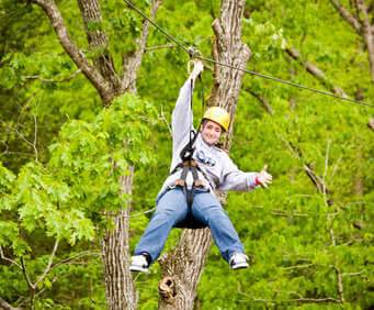 Soaring over the treetops of the Ozarks while ziplining is an adrenaline packed activity for kids of all ages.